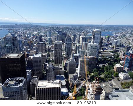 SEATTLE-- JUNE 25: Aerial view of downtown Seattle buildings Union Lake Space Needle and Cranes leading to the horizon on June 25 2016 in Seattle WA.