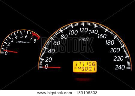 Mileage control display of the speed car. Car control panel night interface on black background.