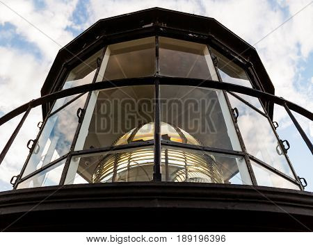 The Fresnel Lens in the Lamp Room of the Currituck Beach Lighthouse in Carolla North Carolina is a complex collection of prism glass.
