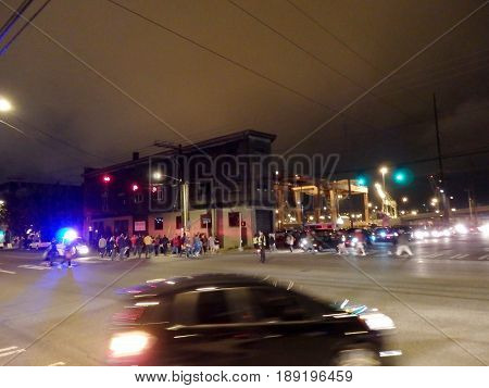 SEATTLE - JUNE 24: Police direct people and traffic at night by the docks after baseball game in Seattle in June 24 2016.