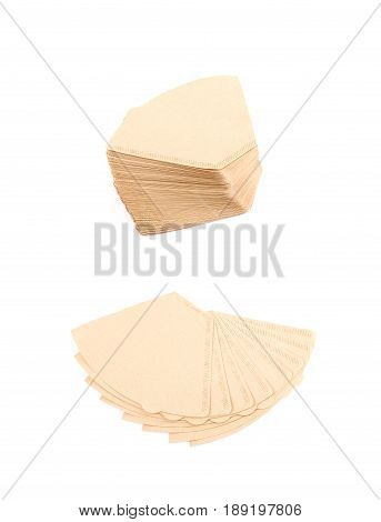 Twisted pile of multiple brown paper coffee filters isolated over the white background, set of two different foreshortenings