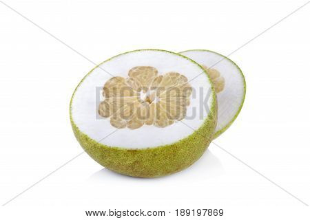 cut ripe pamelo on a white background