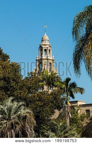 SAN DIEGO, CALIFORNIA - APRIL 28, 2017:  Trees surround the iconic California Tower at the Museum of Man in Balboa Park, built for the 1915-1916 Panama-California Exposition.