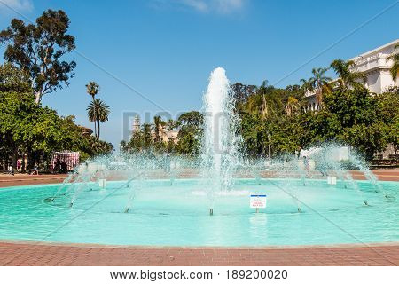SAN DIEGO, CALIFORNIA - APRIL 28, 2017:  The Bea Evenson fountain, located in Balboa Park, an urban cultural park, along with the Natural History Museum and other buildings.