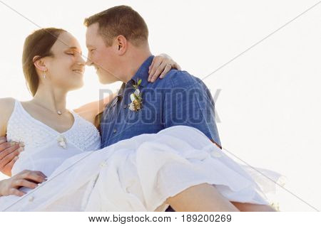 Caucasian man holding wife outdoors