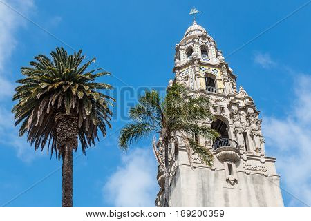 SAN DIEGO, CALIFORNIA - APRIL 28, 2017:  Palm trees at the base of the California Tower in Balboa Park, an historic building built for the 1915-1916 Panama-California Exposition.