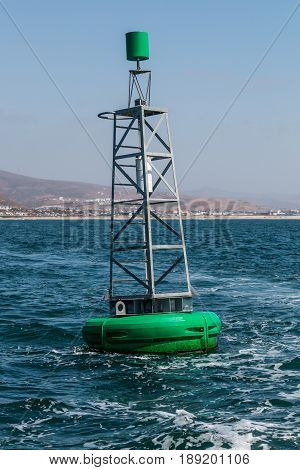 Green buoy in the Ensenada harbor in Baja California in Mexico.