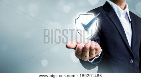 Businessman holding shield protect icon Concept cyber security safe your data