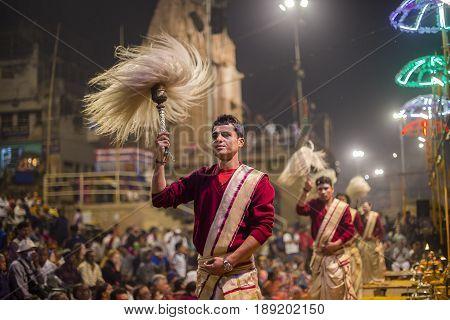 VARANASI INDIA - JANUARY 25 2017 : Unidentified Hindu priest at the religious Ganga Aarti ritual fire puja at Dashashwamedh Ghat in Varanasi Uttar Pradesh India