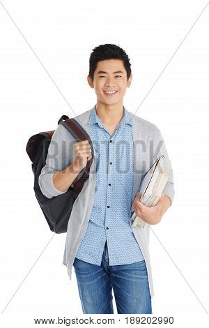 Handsome Vietnamese student looking at camera with toothy smile while standing against white background