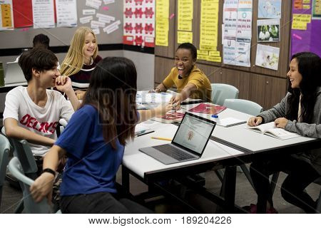 Group of diverse high school students studying in class