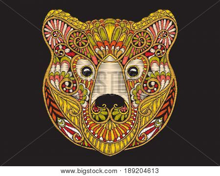 Embroidery ethnic patterned ornate head of brown bear. Stock vector illustration.