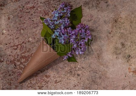 Lilac Flowers Bouquet. Craft Paper Cornet Filled With Spring Blossom Purple Lilac
