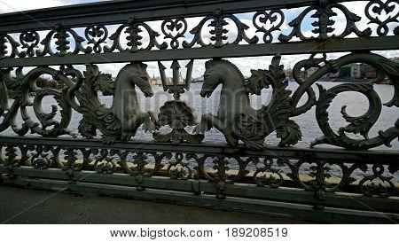 The pattern of the fence of the Blagoveshchensky bridge (former Lieutenant Schmidt bridge) in Saint-Petersburg