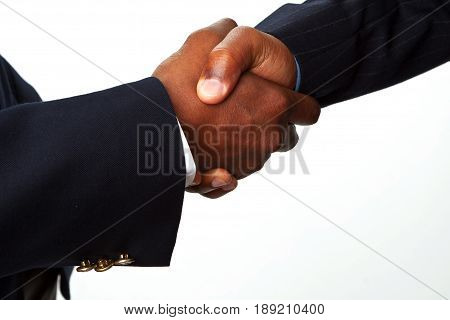 African American businessmen shaking hands making a deal.