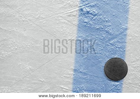 Hockey puck and blue line. Fragment hockey concept