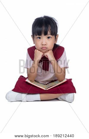 Asian Little Chinese Girl Sitting On Floor And Reading Book
