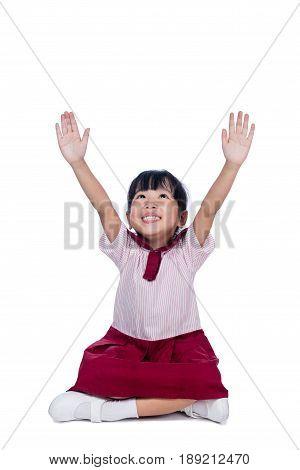Asian Little Chinese Girl In School Uniform Sitting On Floor