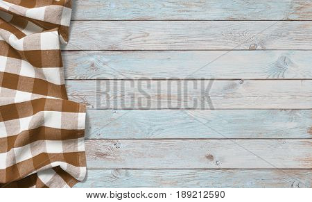 brown picnic cloth on blue wood table