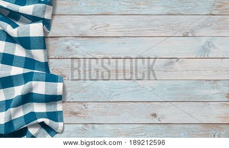 blue picnic cloth on wood table