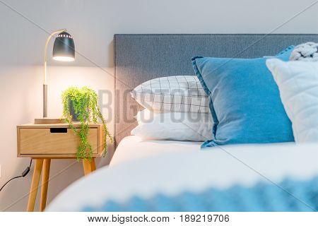 Bedside decor in a modern bedroom setting. Scandinavian interior design.