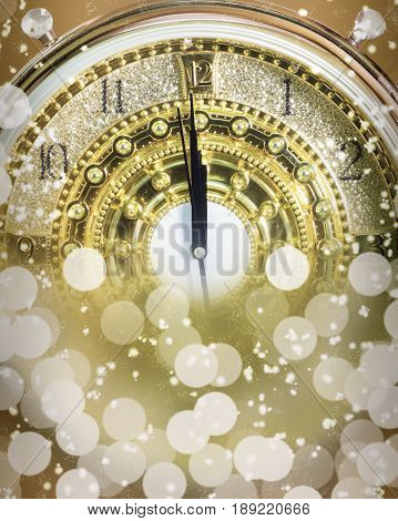 New Year's at midnight time Luxury gold clock countdown to new year effect light.