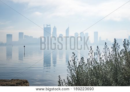 Perth City, Western Australia during a hazy morning after burn offs in the surrounding bushland.