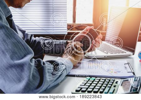 Businessman working and using smart phone in hands touching on a screen.Business concept