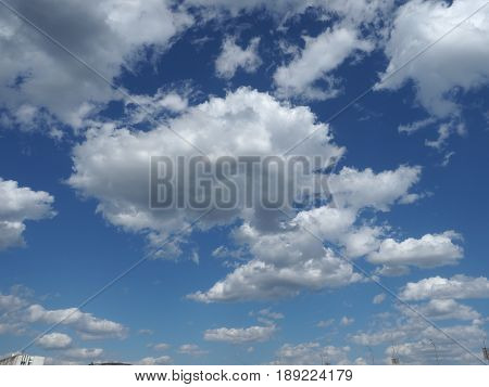 White clouds against blue sky. Nature beautiful background. Deep blue sky and white clouds.