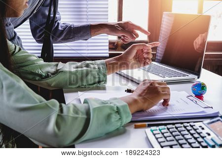 Business adviser analyzing financial figures denoting the progress in the work of the company.Close up.Business analysis and strategy concept.