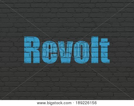 Political concept: Painted blue text Revolt on Black Brick wall background