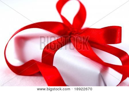 Close up of gift box with red ribbon