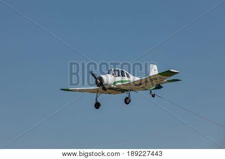 Zbraslavice Czech Republic - May 29 2017. Zlin Z-37 Cmelak - Czech agricultural aircraft is towed by a glider on a sunny day in Zbraslavice.