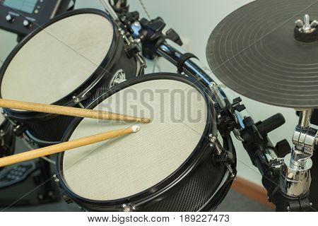 Two wooden sticks beaten on drums gray
