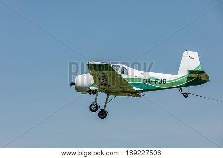 Zbraslavice Czech Republic - May 29 2017. Zlin Z-37 Cmelak - a Czech agricultural aircraft is towed by a glider on a sunny day in Zbraslavice.