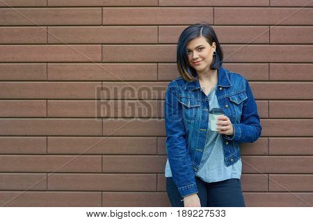 Beautiful  Brunette Young Woman With A Cup Of Coffee