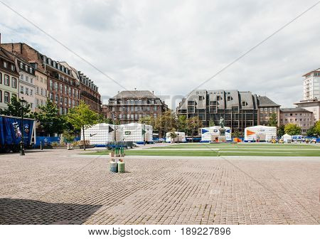 STRASBOURG FRANCE - MAY 19 2016: FFF Tour Federation Francaise de Footaball installation in city center for the upcoming UEFA football soccer Championship - empty place with no pedestrians and General kleber Statue