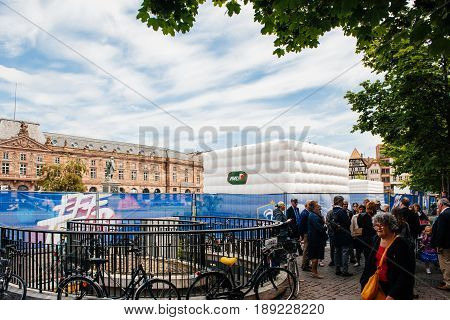 STRASBOURG FRANCE - MAY 19 2016: Pedestrians looking at the FFF Tour Federation Francaise de Footaball installation in city center for the upcoming UEFA football soccer Championship