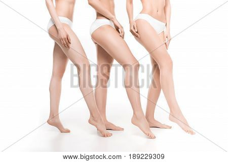 Partial View Of Women In White Underwear Standing In Row Isolated On White