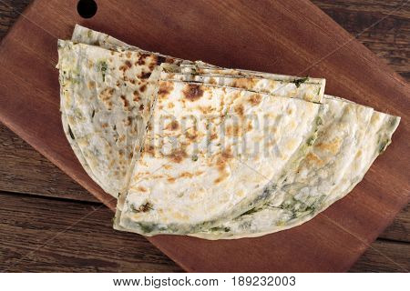 Scallion pancakes. Round unleavened flatbread minced green onions. Top view.