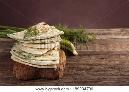 Scallion pancakes. Round unleavened flatbread minced green onions. Copy space.