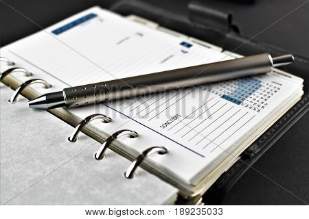 An image of a planner, organiser, calendar with phone