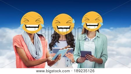 Digital composite of Digitally generated image of female  friends faces covered with emoji using digital tablet against s