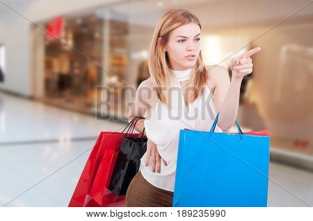 Stylish Shopper At The Mall With Gift Bags