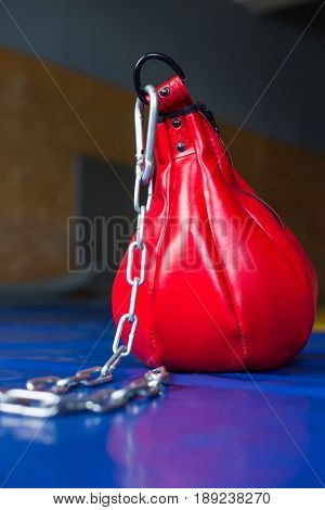 Small Red Punching Bag With Chain Close Up