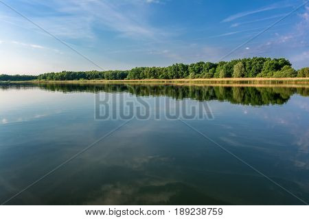 French countryside. Lake Lac de Madine in the Parc Naturel Regional de Lorraine in the early morning after sunrise.