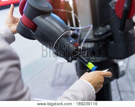 man's hand holds the robot hand Sucker