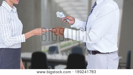 Digital composite of Midsection of businessman giving money to employee in office