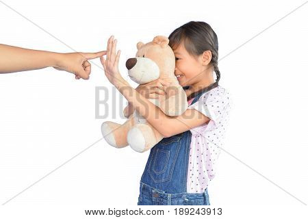 Portrait of little Asian girl scolded on white background