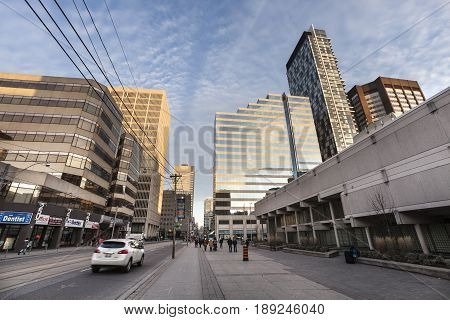 TORONTO, CANADA. December 26, 2014: A street in the center of the city of Toronto in Canada. Broad perspective view. Skyscrapers and modern buildings. Downtown Toronto, Canada